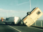 High winds blow caravan off bridge in France